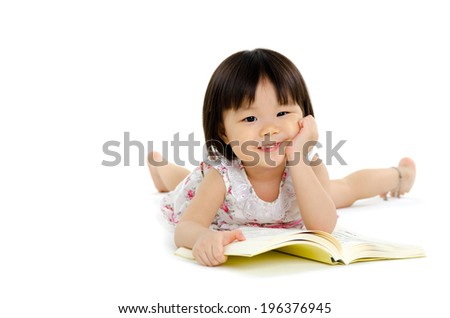 Lovely asian kid lying on the floor - stock photo