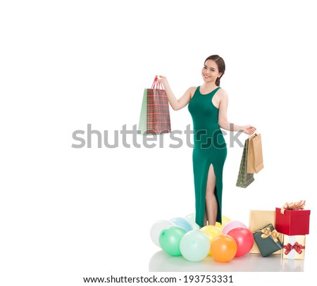 Lovely Asian woman with many paper bags and gift boxes - stock photo