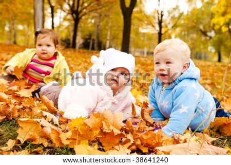 Lovely babies enjoying time  in the autumn park