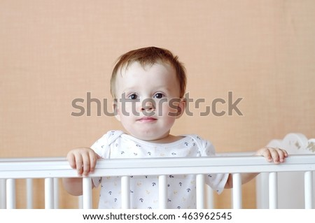 lovely baby age of 11 months in white bed