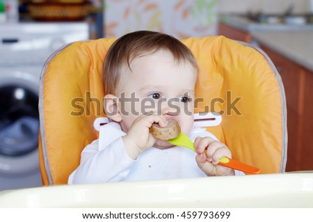 lovely baby age of 1 year eating bread