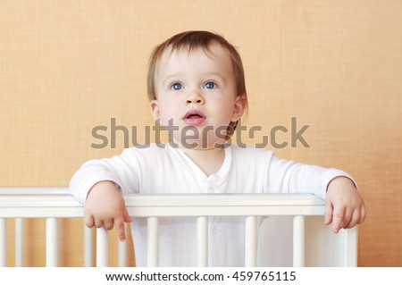 lovely baby age of 1 year in white bed