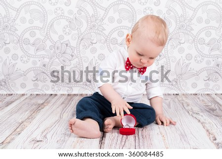 Lovely baby boy pose with betrothal ring