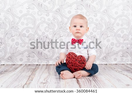 Lovely baby boy pose with red wattled heart - stock photo