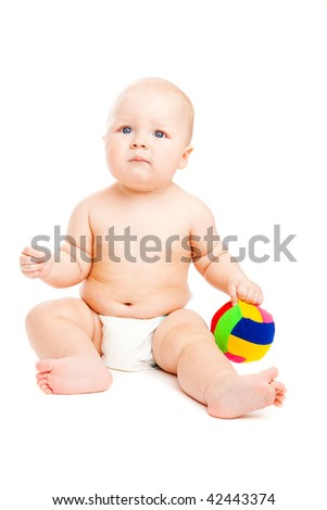 Lovely baby holding a small colorful ball - stock photo