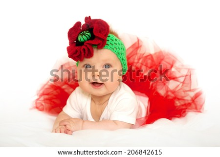 Lovely baby princess in red tutu dress and headband on a white background - stock photo