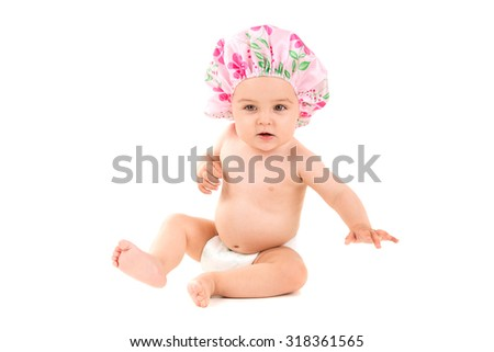 Lovely baby with shower cap isolated in white