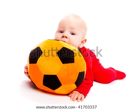 Lovely  baby with soccer ball - stock photo
