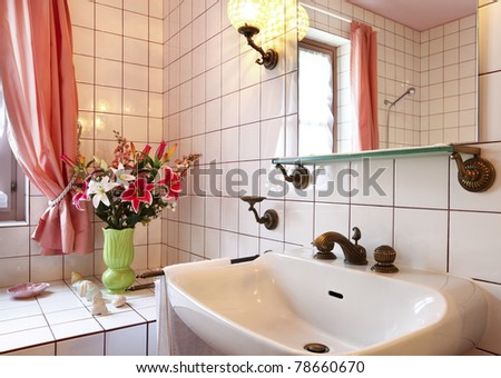 lovely bathroom in style classical, sink and mirror - stock photo