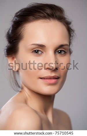 Lovely beautiful woman smiling at camera - stock photo