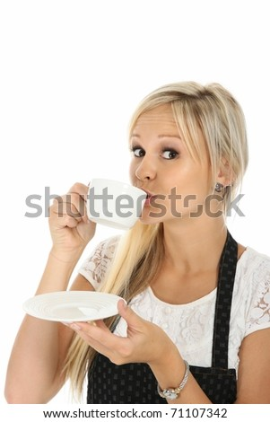 Lovely blond girl sipping a cup of hot beverage - stock photo