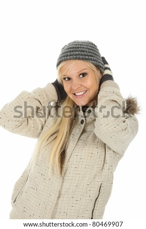 Lovely blond girl with gorgeous smile dressed in winter wool - stock photo