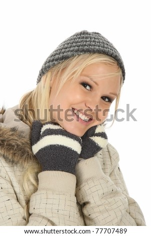 Lovely blond girl with gorgeous smile dressed in winter woollies - stock photo