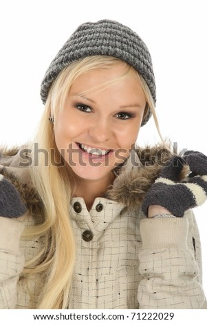 Lovely blond lady in knitted winter cap and gloves - stock photo