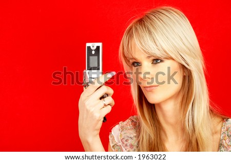 lovely blond with phone over red background - stock photo