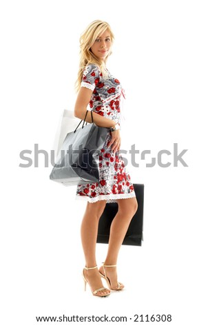lovely blond with shopping bags over white - stock photo