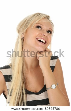 Lovely blond woman with gorgeous smile and looking upwards - stock photo