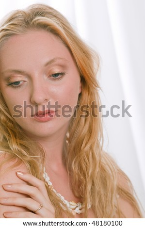 lovely blonde female model with flawless complexion against white background