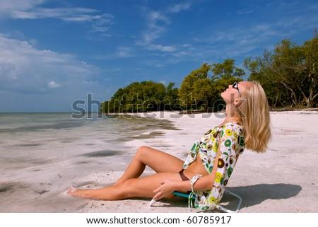 lovely blonde female sunning on florida keys beach - stock photo
