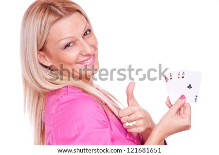 Lovely blonde in a pink jacket holding poker of four aces and showing ok with thumb-up, isolated on white - stock photo