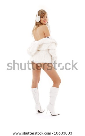 lovely blonde in boots, fur and headphones - stock photo