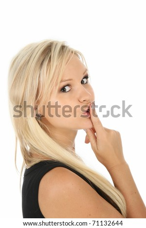 Lovely blonde lady with finger on lips in be quiet sign - stock photo