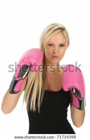 Lovely blonde lady with pink boxing gloves and aggressive expression - stock photo