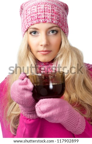 lovely blonde woman holding cup of drink and looking at camera - stock photo
