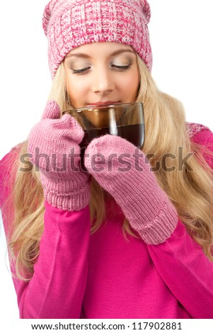 lovely blonde woman holding cup of drink over white - stock photo