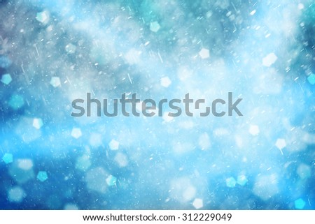 Lovely blue colored abstract snowfall Christmas and New Year illustration background. Beautiful blue colored Christmas and New Year Holiday greeting card with place for message. - stock photo