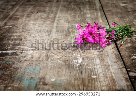 lovely bouquet of wild flowers on a textured board. focus on the petals of a flower. there is room for designer labels . Picture perfect for greetings and announcements - stock photo