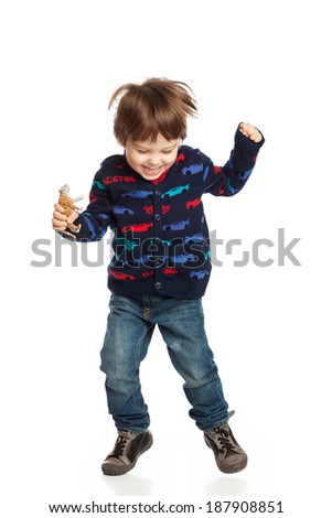 Lovely boy jumping for joy, isolated on white - stock photo