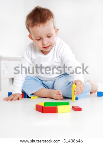 Lovely boy playing with blocks - stock photo