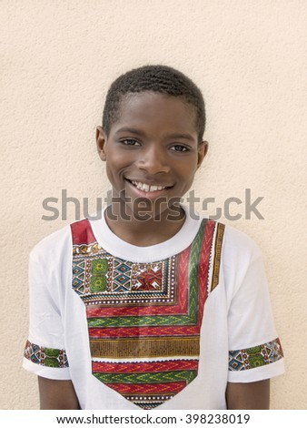 Lovely boy wearing a Ghanaian-styled t-shirt, ten years old - stock photo