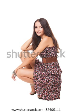 lovely bright young woman squatting on white background - stock photo