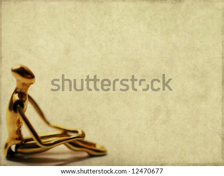 lovely brown background image with interesting earthy texture, close-up of a golden figure and plenty of space for text