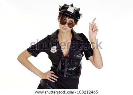 Lovely brunette in a suit of police on a white background - stock photo