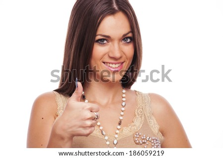Lovely brunette showing like sign with thumbs up - stock photo