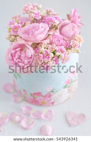 Lovely bunch of flowers .Beautiful fresh roses flowers in a box decorated with a heart .