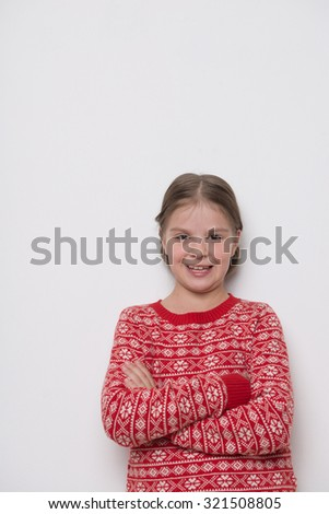 Lovely caucasian little girl wearing red christmas sweater - stock photo