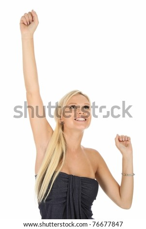 Lovely cheering blond woman with arms up - stock photo