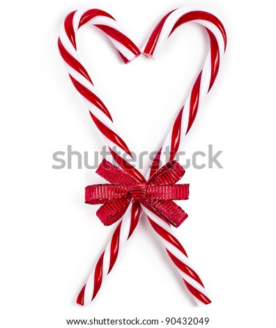 lovely Christmas candy cane in heart form isolated on white - stock photo