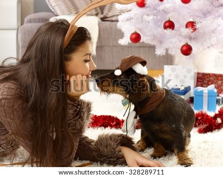 Lovely christmas photo of woman and dog in harmony. - stock photo