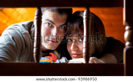 Lovely couple at home. Looking at the camera. - stock photo
