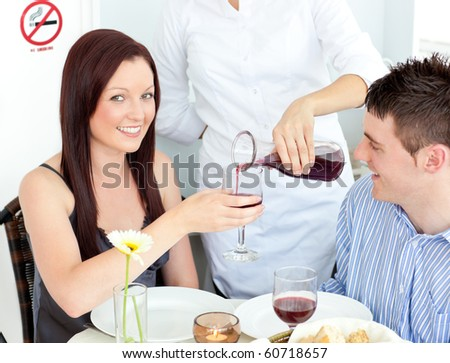 lovely couple drinking wine during dinner at the restaurant