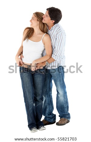 Lovely couple hugging and looking away - isolated over a white background - stock photo
