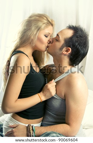 lovely couple  in bed - stock photo