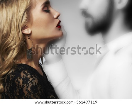lovely couple in tenderness.Beautiful woman meeting with the spirit of man.beauty girl and boy together.ghost touch on Saint Valentine's Day - stock photo