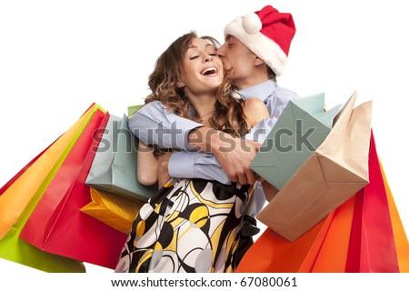 Lovely couple making christmas shopping. Isolated on white. - stock photo