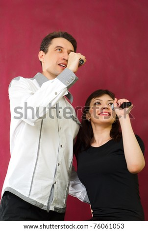 lovely couple singing on red burgundy background - stock photo
